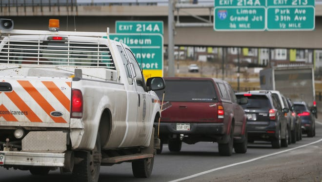 In this file photograph taken Friday, Feb. 20, 2015, traffic comes to a standstill along Interstate 25 in downtown Denver. Voter-sanctioned tax limits could someday jeopardize Colorado's economic success, which depends on good roads.