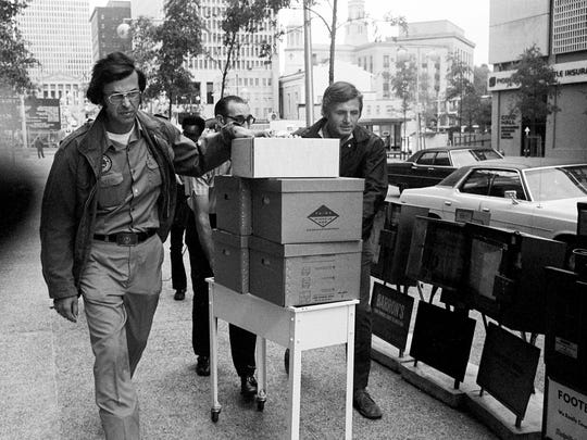 FBI agents Phil Thune, left, and Henderson Hillin Jr. are taking files from the State Department of Correction in downtown Nashville Oct. 26, 1976. Files on 318 persons who received executive clemency, pardons or commutations of their sentences from the office of Gov. Ray Blanton have been subpoenaed by a federal grand jury.