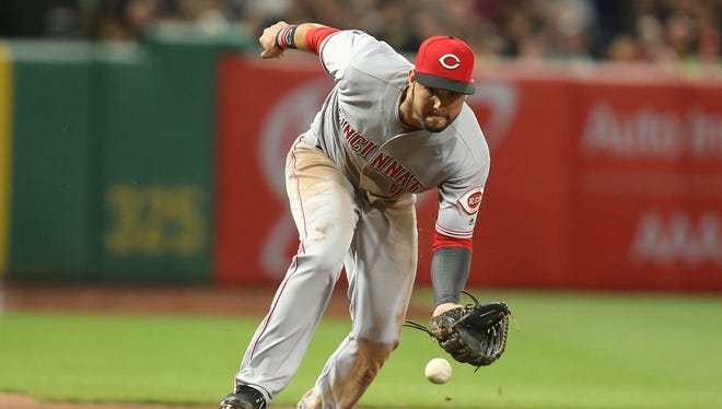 Eugenio Suarez fields a ball in Monday's game in Pittsburgh.