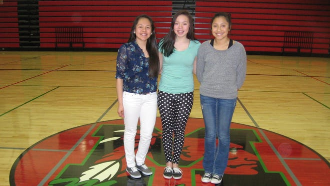 Basketball players at Meskwaki Settlement School have found role models in Shoni and Jade Schimmel, two Native American sisters at Louisville who have earned national attention for their on-court successes. Pictured from left, Marcelena Guevara, Kailee Pushetonequa and Grace Tahahwah.