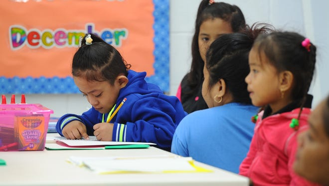 Kindergarten students attend the first day of public school classes at Chief Brodie Memorial School in Tamuning on Thursday, Aug. 18, 2014.