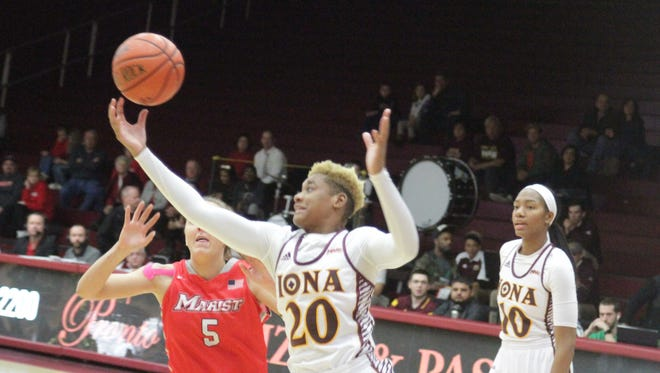 Iona's Alexis Lewis (20) grabs a rebound away from Marist's Lovi Henningsdottir (5) during a college women's basketball game between Iona and Marist at the Hynes Center in New Rochelle on Sunday, January 15th, 2017. Marist won 68-62.