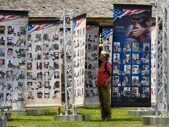 People view portions of the Tribute Towers National Traveling Memorial during the Benton County Fair Wednesday, Aug. 2, 2017 in Sauk Rapids.