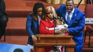 Antonio LeGrier (R) father of Quintonio LeGrier, stands with family as he eulogizes his son during funeral services at New Mount Pilgrim Missionary Baptist Church in Chicago. LeGrier, 19, was shot several times and killed by a Chicago police officer responding to a domestic disturbance call Dec. 26, 2015. Police at the same time mistakenly fatally shot LeGrier's neighbor, Bettie Jones.