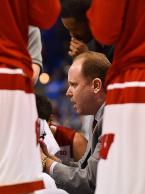 Wisconsin Badgers head coach Greg Gard speaks to his team during the first half of the game in the first round against the Pittsburgh Panthers in the 2016 NCAA Tournament at Scottrade Center.
