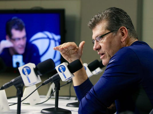 Connecticut coach Geno Auriemma speaks Sunday, March 30, 2014, at a news conference ahead of a regional finals game in the NCAA college basketball tournament in Lincoln, Neb. Connecticut will play Texas A&M in the finals on Monday. (AP Photo/Nati Harnik)
