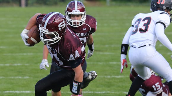 Scarsdale's Stephen Nicholas is tripped up by White