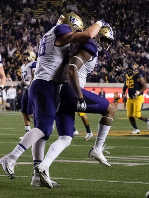 Washington Huskies tight end Darrell Daniels (15) celebrates with tight end Drew Sample (88) after scoring a touchdown against the California Golden Bears during the first quarter at Memorial Stadium.