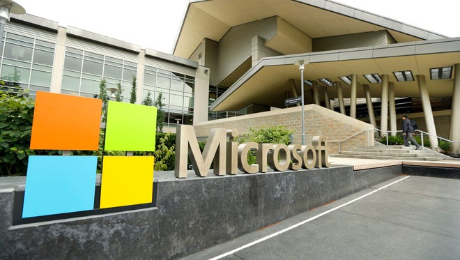 FILE - This July 3, 2014 file photo shows Microsoft Corp. signage outside the Microsoft Visitor Center in Redmond, Wash. On Wednesday, Jan. 22, 2015,  Microsoft will talk about how its upcoming Windows 10 operating system will be consistent across various devices, yet familiar to those who have used past systems on PCs, as the company addresses lackluster reception for the current Windows 8. (AP Photo Ted S. Warren, File)