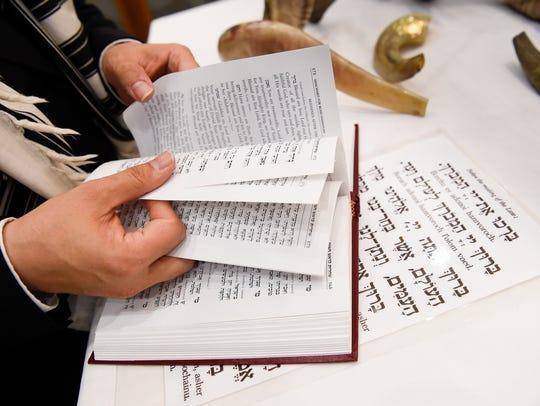 Rabbi Yitzchok Tiechtel reads through passages as he