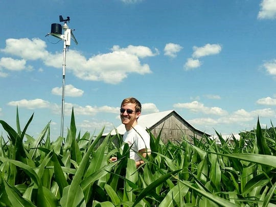Alex Adams, CEO of GeoAir, poses in a corn field in East Tennessee. GeoAir uses drones to detect mold spores before they damage crops.