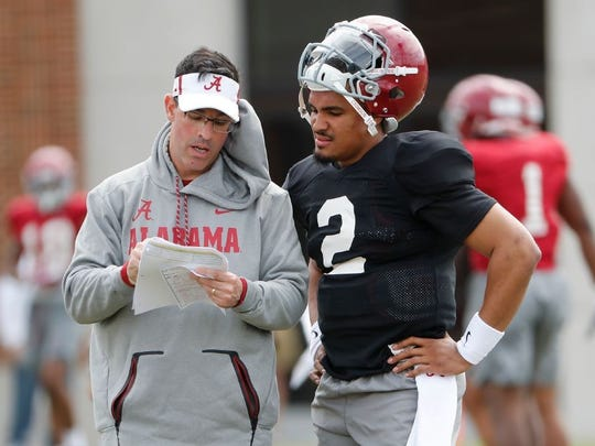 Dan Enos with quarterback Jalen Hurts at spring practice in April.