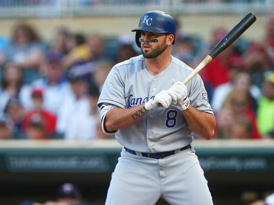 Kansas City Royals' Mike Moustakas bats against the Minnesota Twins in the first inning of a baseball game Tuesday, July 10, 2018, in Minneapolis.
