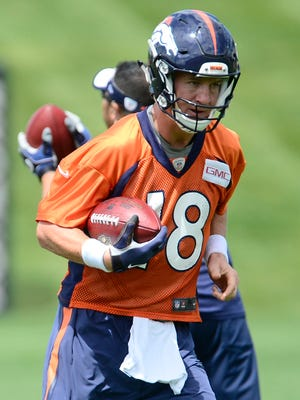 Peyton Manning runs a drill during the first Broncos OTA session on Wednesday.