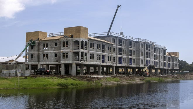 Two residential buildings and a 15,000-square-foot clubhouse are under construction as part of the new Arcadia Gardens luxury rental community for active seniors in Palm Beach Gardens. The man-made lake in the foreground also was created for the project.