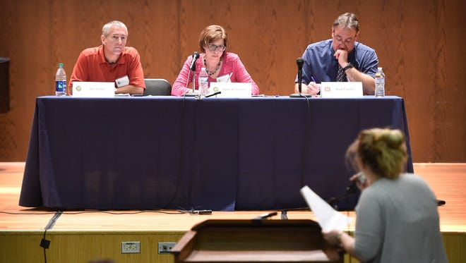 Bart Jensen, Joanne Wachholder, and Wade Chandler listen to citizens who attended The Federal Energy Regulatory Commission (FERC) public meeting at Lebanon Valley College, Tuesday June 14.