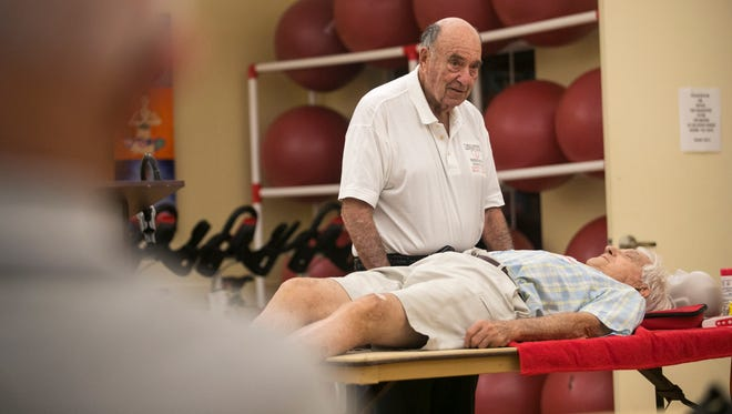 Stan Barton, 88, teaches a CPR class with the help on Ned Gamsky at the Island Club in Lexington Country Club in south Fort Myers. He has been teaching CPR for more than 40 years