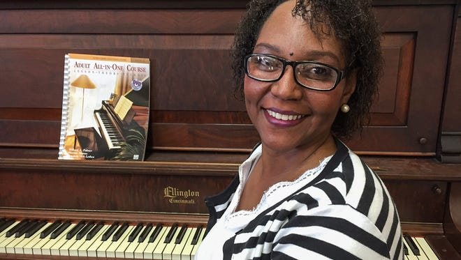 Army veteran Angela Darwiche-Smith, who is receiving services from Hoosier Veterans Assistance Foundation, says music heals her heart. She is taking piano lessons from teacher Nancy Hart, who volunteers her time.