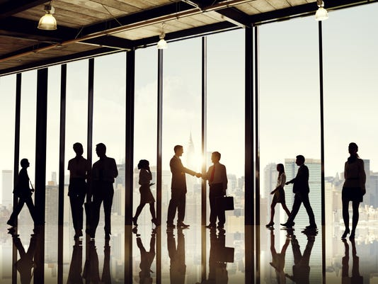 Silhouette businesspeople entering office building