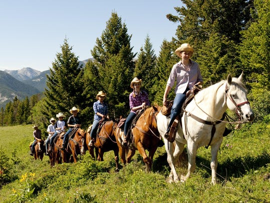 Teens trail riding