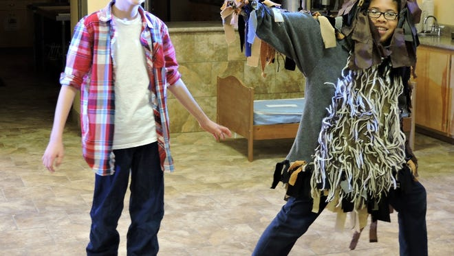 Milo (Isaak Chacón, left) and his friend, Tock, the Watch Dog (Ethan Cruz), rehearse a scene from the Phantom Tollbooth.
