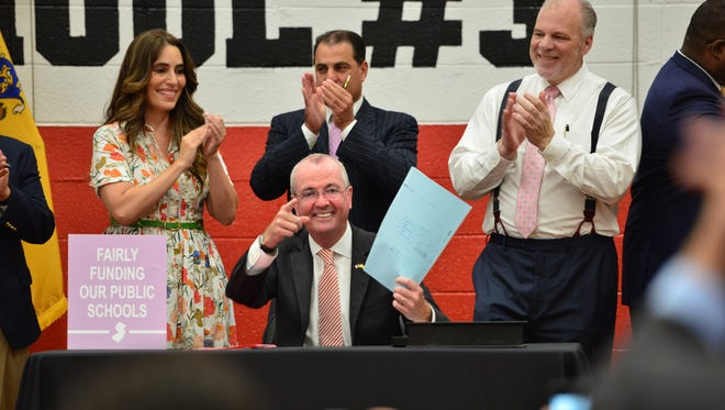 New Jersey Governor Phil Murphy signs school funding legislation at Cliffside Park School No. 3 at Cliffside Park on Tuesday July 24, 2018.