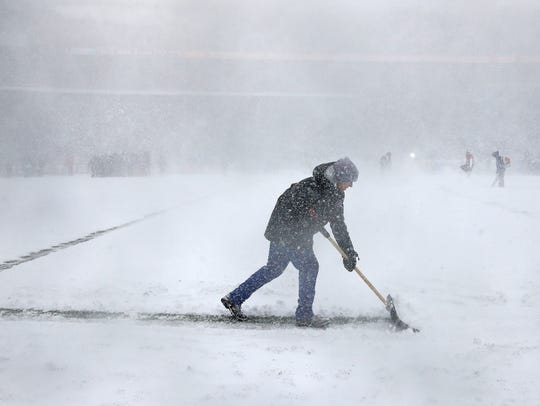 Heavy snow in Buffalo makes playing conditions nearly