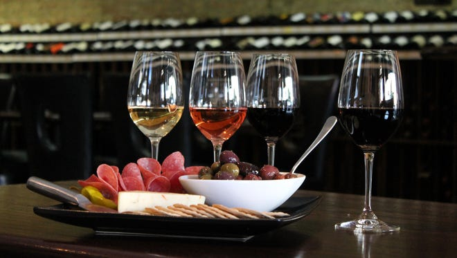 Sausage, cheese, olives and many other sharable foods are part of Uncorked's appeal as a place to sit and converse with friends.