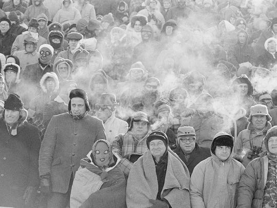 Fnas watch the Packers play the Dallas Cowboys in the NFL championship game on Dec. 31, 1967, in Green Bay.