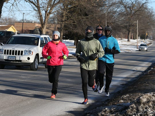 Members of the Capital Striders running group train Feb. 28 in Des Moines.