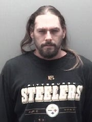 This photo provided by the Eaton County Sheriff's Department shows Robert Carabello.