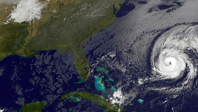 A satellite image shows Hurricane Nicole (right) roaring toward Bermuda on Oct. 12, 2016.