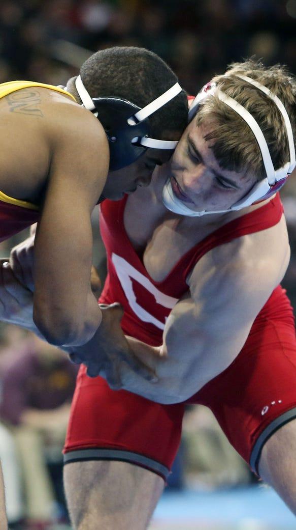 Cornell's Brian Realbuto wrestles against Iowa State's