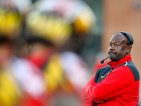 Maryland interim head coach Mike Locksley watches from the sideline in the second half of an NCAA college football game against Indiana, Saturday, Nov. 21, 2015, in College Park, Md. Indiana won 47-28.