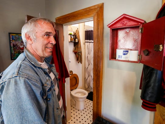 Nick Sibley keeps an emergency supply of toilet paper in his 300-square-foot house at Mt. Vernon Street and South Main Avenue that was once a gas station.