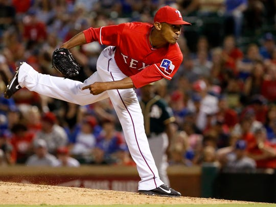 Sam Freeman of the Texas Rangers pitches against the