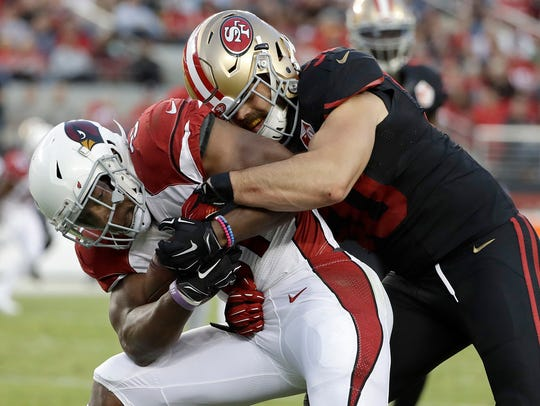 San Francisco 49ers linebacker Nick Bellore, right,