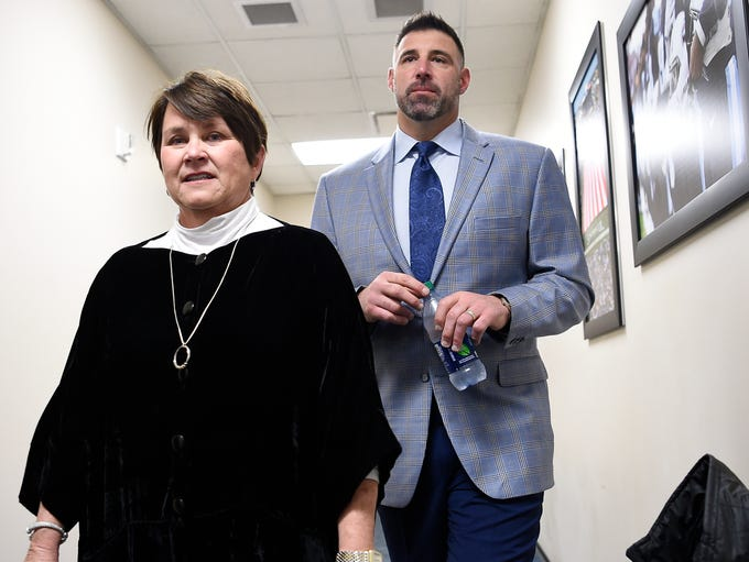 The Titans controlling owner Amy Adams Strunk walks