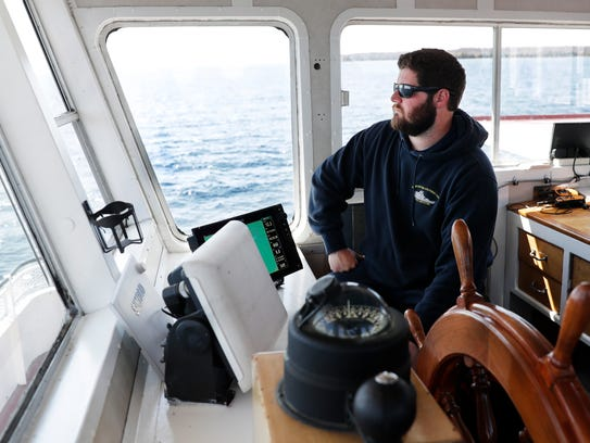 David Heath, a junior captain with the Washington Island Ferry Line, pilots the ferry Washington between Northport and Washington Island on May 17, 2018. Sarah Kloepping/USA TODAY NETWORK-Wisconsin