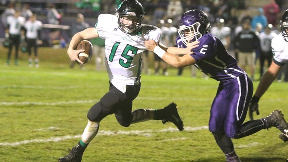 Trey Robinson of Mountain Heritage (15) had 218 yards of offense and four touchdowns in Friday's 34-7 win at Mitchell.