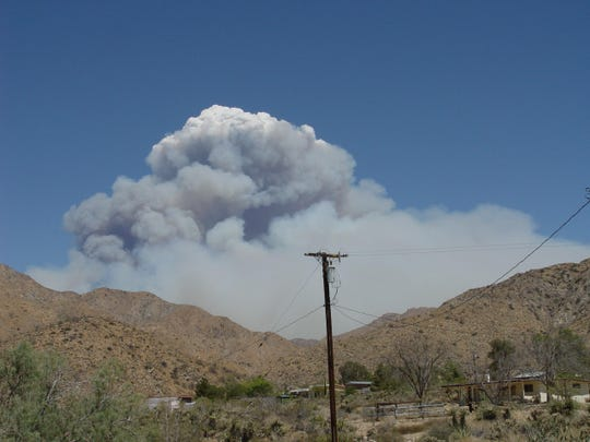 High winds and heat caused the Lake Fire to blow up creating its own snow white clouds atop the enormous smoke plumes.