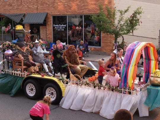 Members of the Verlen Kruger Memorial ride this Wizard of Oz themed float in the Portland Independence Day parade.