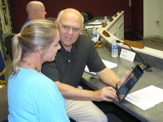 Lakeside Park Council Members Rebecca Stewart and Dennis Landwehr review the city's new website on a tablet.
