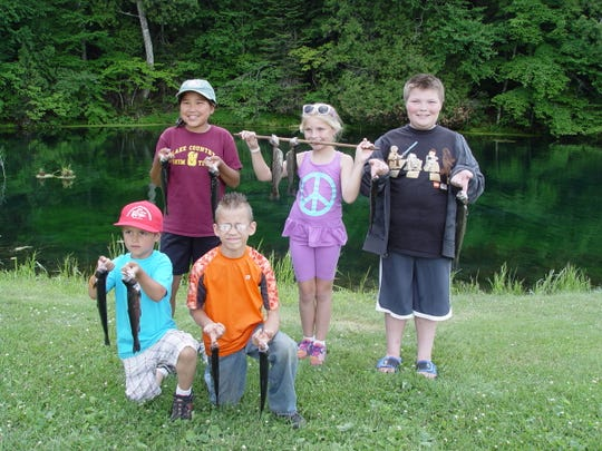 Some children visited a trout hatchery in Watersmeet, Michigan as part of the Guides/Kids Fishing Day on Thursday, July 10 in Eagle River.
