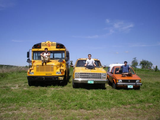 Skinny Pancake co-owner Benjy Adler (left), with friends Mike Rimoin (center) and Jon Warnow. Rimoin and Warnow managed The Skinny Pancake cart during its second summer. The school bus Adler is sitting on is called Sueno, which has been painted, converted to run on vegetable oil and is used to serve food at festivals.