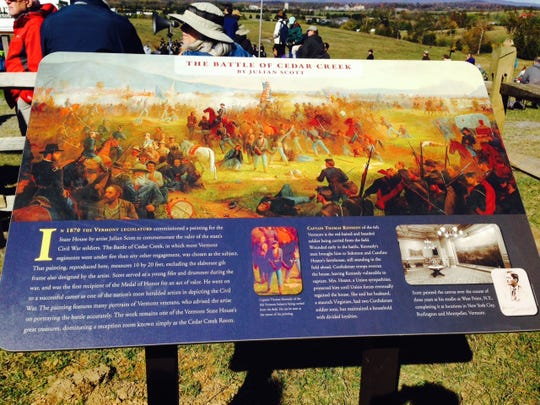 New display sign at Cedar Creek Battlefield shows the painting by Julian Scott that hangs in the Vermont Statehouse. The painting features many Vermonters during the battle.