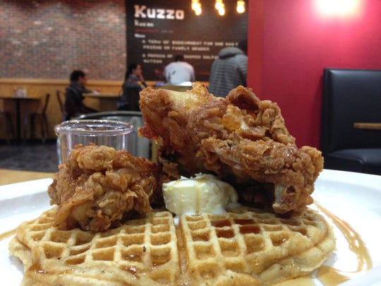 Kuzzo's offers the What Up Doe, a chicken and waffles dish that includes three pieces of chicken, two waffles, grits, eggs and cheese.
