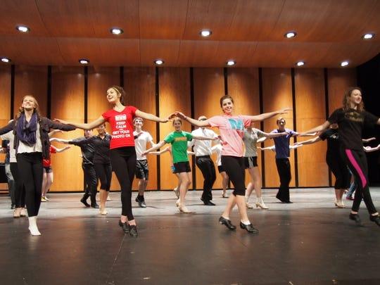 Fond du Lac High School students practice a tap dance routine.