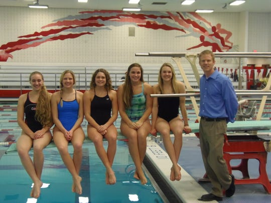 Five members of Canton's varsity girls swimming and