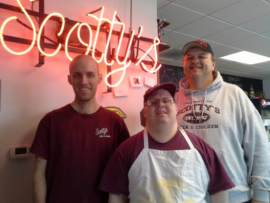 Scotty (right) with two employees hired through ODC.jpg